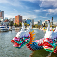 Dragon boats on the Willamette River with downtown Portland, Oregon in the background