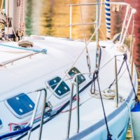 Yachting and Fishing Theme. Modern Yacht in the Marina Closeup Photo.